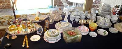 Estate Sale- china and serving pieces on display