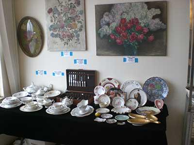 Estate Sale - china and wall decor on display