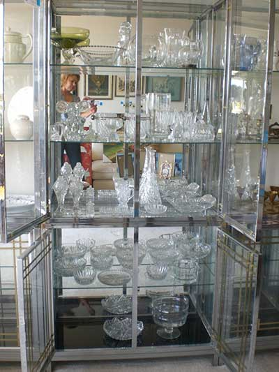Estate Sale - crystal displayed in a cabinet