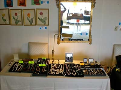 Esate Sale - jewelry and wall decor on display