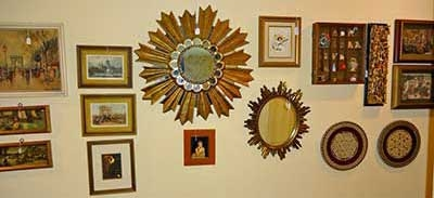 Estate Sale - paintings and other wall decor on display