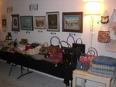 Estate Sale - purses and wall decor on display