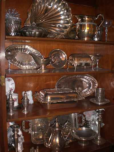 Estate Sale - silver items on display on shelves