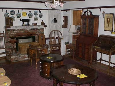 Estate- Sale - wooden furniture on display