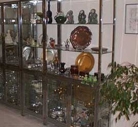 estate sale - shelves of household items on display